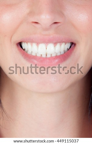 Smiling woman mouth with great teeth. Close up - stock photo