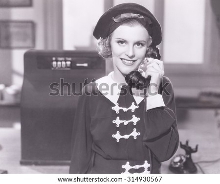 Smiling woman on the telephone - stock photo