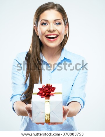 Smiling woman present gift box with red ribbon. Business woman isolated studio portrait. - stock photo