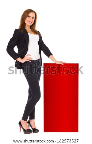 Smiling woman presents poll results. Cheerful business woman standing and holding red bar chart.. Full length studio shot isolated on white. - stock photo