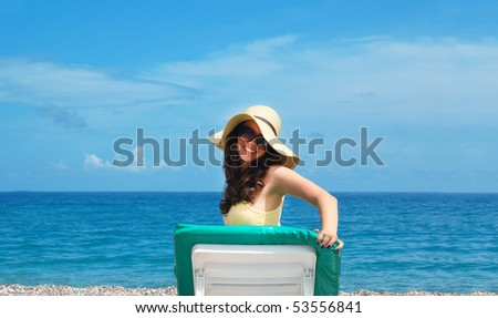 Smiling woman relaxing at the seaside - stock photo