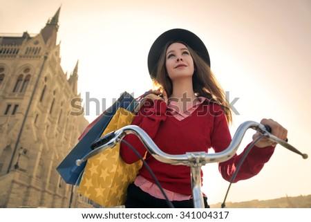 Smiling woman riding a bike - stock photo