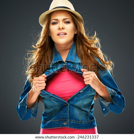 smiling woman ripping clothes on chest. copy space for advertising sign. - stock photo