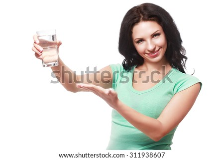 smiling woman show glass of clean water - stock photo