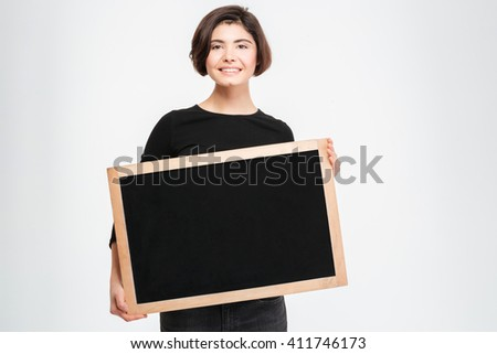 Smiling woman showing blank board isolated on a white background - stock photo