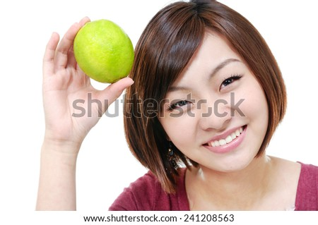 smiling woman showing limes - stock photo