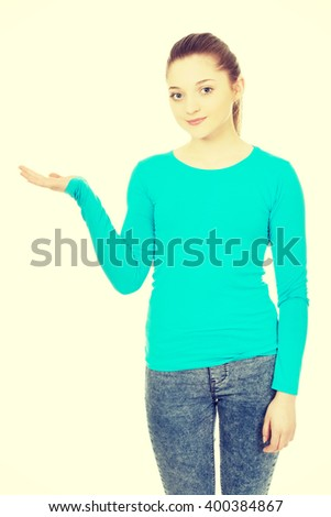 Smiling woman showing something on palm. - stock photo