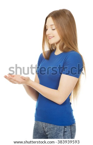 Smiling woman showing something on palms. - stock photo