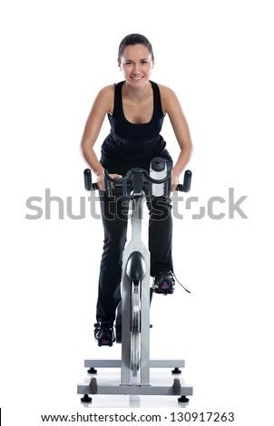 Smiling woman training on exercise bike - stock photo