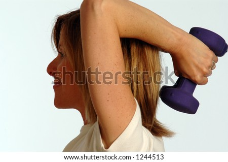 smiling woman using weights for fitness - stock photo