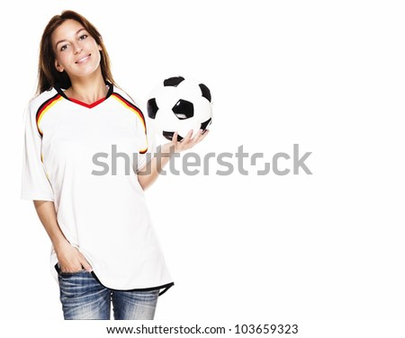 smiling woman wearing football shirt presenting a football on white background - stock photo