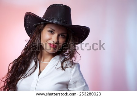 Smiling woman with cowboy hat - stock photo