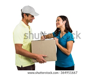 Smiling woman with delivery man holding cardboard box on white background - stock photo