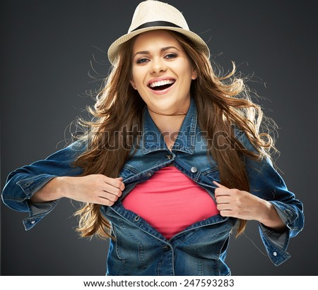 smiling woman with long hair ripping his clothes. copy space for advertising sign. - stock photo