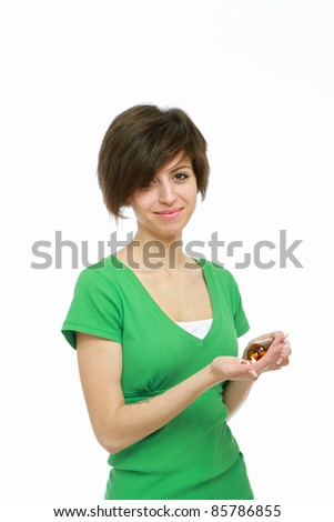 Smiling woman with pills isolated on white background - stock photo