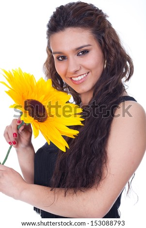 smiling woman with sunflower in hand - stock photo
