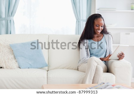Smiling woman with tablet - stock photo