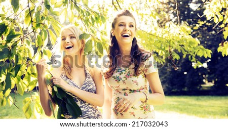 Smiling women relaxing in the park - stock photo