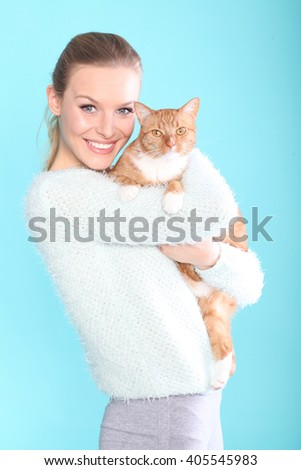 Smiling women with a cat - stock photo