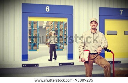 smiling worker outside of warehouse - stock photo