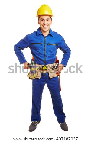 Smiling worker with blue overall and hardhat and a tool belt - stock photo