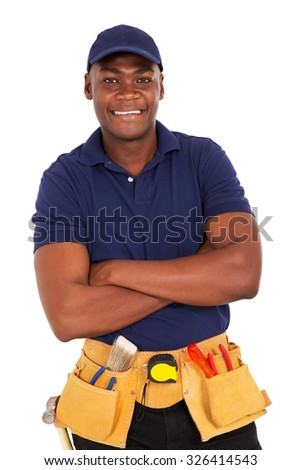smiling young african repairman looking at the camera - stock photo