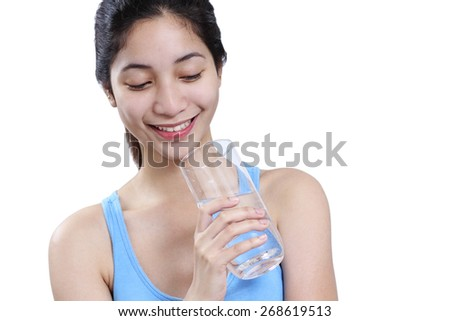 Smiling young asian lady holding a glass of water.Isolated in white background. - stock photo