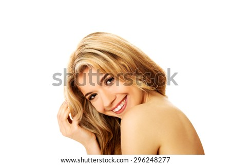 Smiling young beautiful woman looking at the camera - stock photo