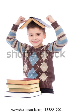 Smiling young boy with a book on his head over white background - stock photo