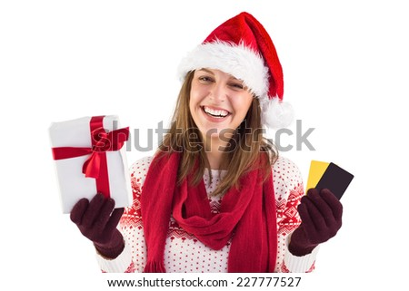 Smiling young brunette with gift and credit card on white background - stock photo