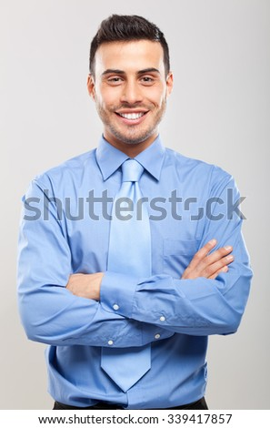 Smiling young business man isolated on white - stock photo