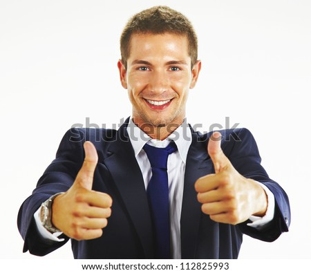 Smiling young business man thumbs up - stock photo