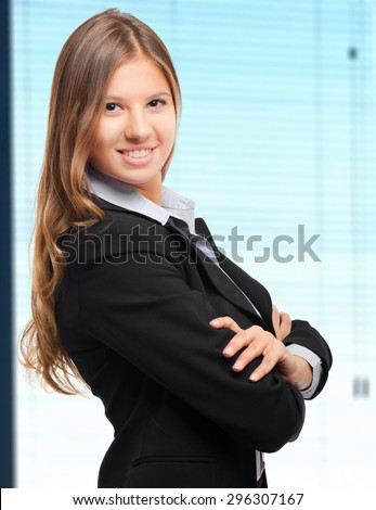 Smiling young business woman portrait - stock photo