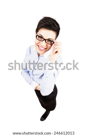 Smiling young business woman with eyeglasses looking at camera. High angle view wide lens full body length portrait isolated over white background. - stock photo