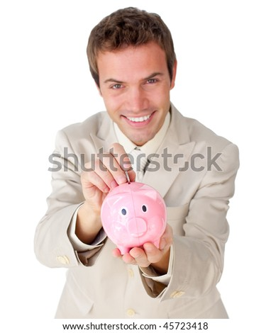 Smiling young businessman saving money in a piggy-bank against a white background - stock photo