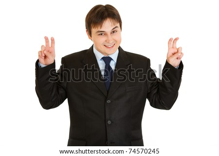 Smiling young  businessman showing air quotes gesture  isolated on white - stock photo