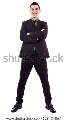 Smiling young businessman standing with his arms crossed in full length pose, isolated on white background, business concept - stock photo