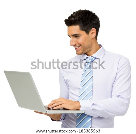Smiling young businessman using laptop against white background. Horizontal shot. - stock photo