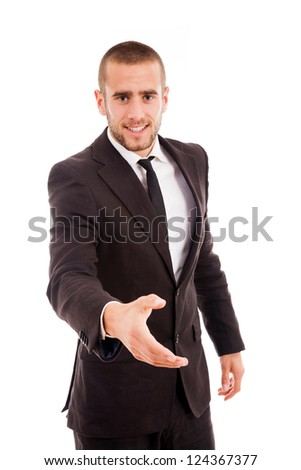 Smiling young businessman with an open hand ready to seal a deal - stock photo