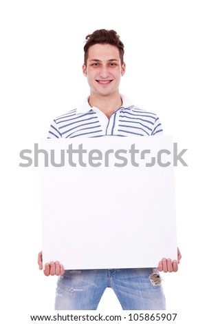 Smiling young casual man holding white sign to write it on your text isolated on white background - stock photo
