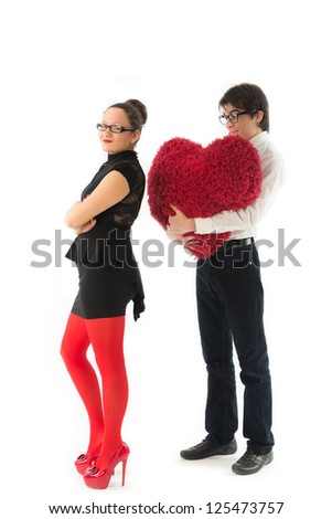 smiling young couple holds a large hairy red heart celebrating Valentine\s Day - stock photo