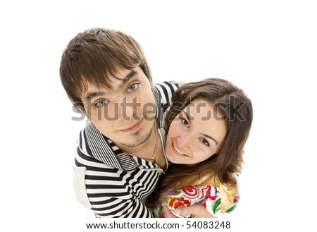 smiling young couple in love isolated on white - stock photo