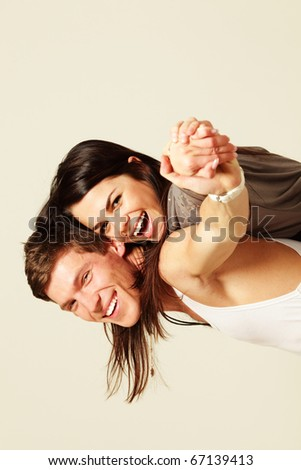 Smiling young couple isolated - stock photo