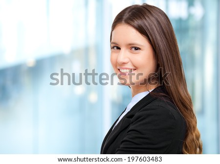 Smiling young female manager in the office - stock photo