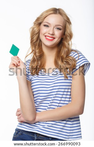 Smiling young female showing blank credit card, on white background - stock photo