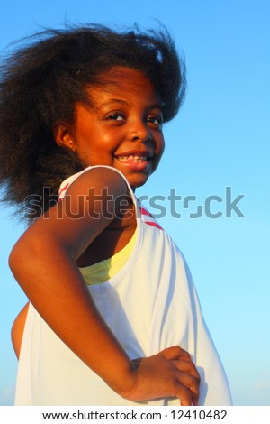Smiling young girl glancing over her shoulder - stock photo