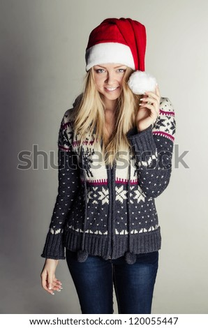 smiling young girl in red santa hat - stock photo