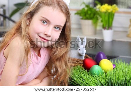 Smiling young girl in the Easter atmosphere - stock photo