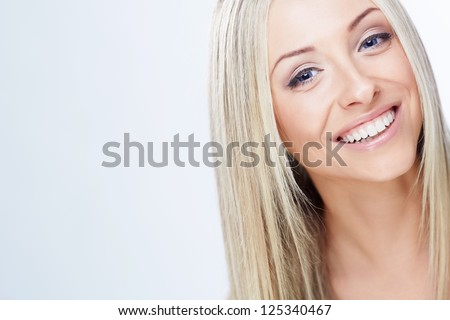 Smiling young girl on a white background - stock photo