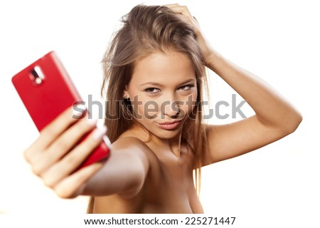 smiling young girl takes a selfie - stock photo
